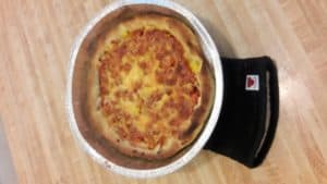 Chicago deep dish pizza, fully cooked.