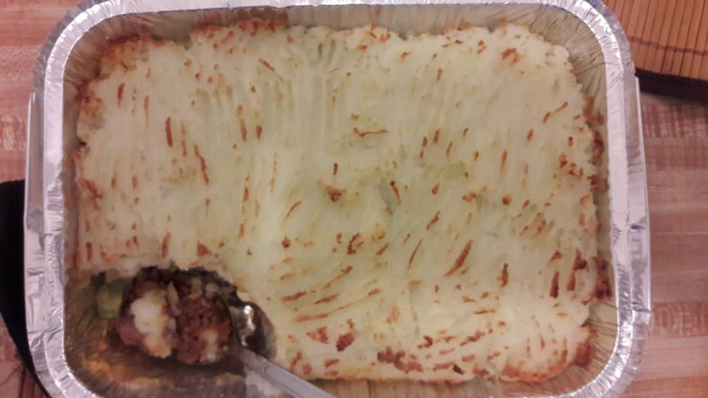 A pan of Shepherd's Pie with a piece missing