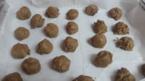 whole wheat tahini cookie dough balls on baking tray