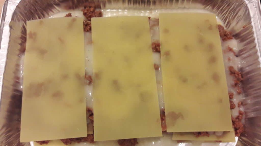Fully constructed meat lasagna (sans bechamel sauce) in aluminum baking pan ~ bitesnpieces.co