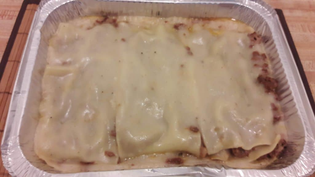Fully cooked meat lasagna in aluminum pan ~ bitesnpieces.co