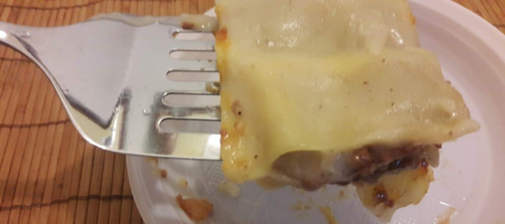 spatula holding a piece of cooked meat lasagna ~ bitesnpieces.co