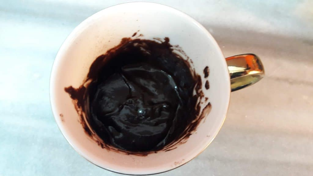 Overhead shot of mug containing mixed brownie batter