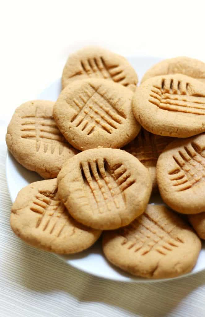 A bunch of peanut butter cookies on a white plate