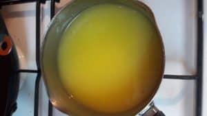 Pot containing bright yellow lemon curd