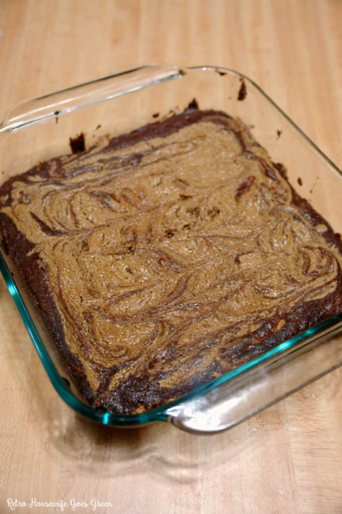 Peanut butter swirl brownies in a glass baking tray