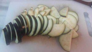 eggplant slices on a cutting board.