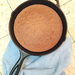 Baked honey cake in cast iron skillet.